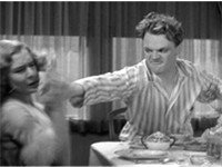 Cagney smashes a grapefruit into Mae Clarke's face in a famous scene from Cagney's breakthrough movi