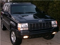 A Deep Slate 1998 Grand Cherokee 5.9 L (Note hood louvers and mesh grill inserts)