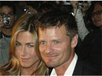 Aniston, with Steve Zahn, at the premiere of Management, in which she starred.