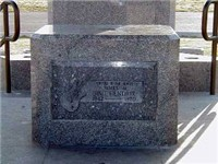 The original gravestone of Jimi Hendrix, incorporated into the granite base of his memorial where a