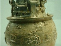 Jar of the Western J n, with Buddhist figures.