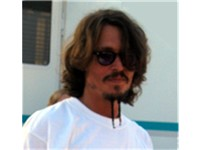 Depp with longer hair, mustache and goatee similar to the style used in Pirates of the Caribbean: Th