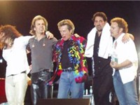 Journey in 2002: Steve Augeri, Jonathan Cain, Ross Valory, Deen Castronovo, and Neal Schon