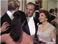 Karl Malden with Claudette Colbert in the trailer for Parrish (1961)