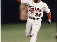 Kirby Puckett triumphantly rounding the bases after hitting a dramatic game-winning home run in Game