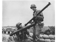 Anti-armor firepower: US infantrymen comparing the early-model M9 bazooka (right) to the larger M20 