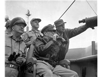 The Supreme Commander: Gen. MacArthur, UN Command CiC (seated), observes the naval shelling of Inche