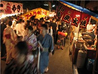 Food and crafts adorn every street during the Gion matsuri. Photo taken 2007.