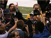 Les Miles celebrates his team's victory in the 2008 BCS National Championship Game.