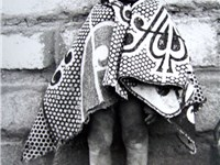 Boy wrapped in a Basotho blanket.