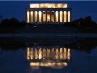 The Memorial is mirrored in the Reflecting Pool at night