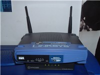 A 802.11b wireless Linksys router with a wired 4-port switch.