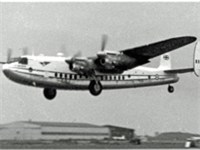 Avro York of the based Air Charter Ltd taking off on a trooping flight in 1955 with wartime hangars