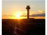 The control tower at London Stansted, located at the north east of the airfield viewed at sunset.