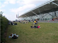 The lawn in front of Stansted Airport, which attracted many passengers before being paved to widen t