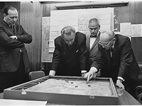 Walt Whitman Rostow showing President Lyndon B. Johnson a model of the Khe Sanh area in February 196
