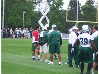 Sanchez (red jersey) at a June 2009 New York Jets mini-camp in Florham Park, New Jersey