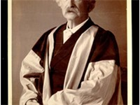 Mark Twain in his gown (scarlet with grey sleeves and facings) for his DLitt degree, awarded to him 