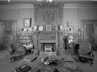 The library of the Mark Twain House, which features hand-stenciled paneling, fireplaces from India,