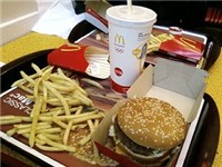 A McDonald's Big Mac combo meal served with French fries and Coca-Cola.