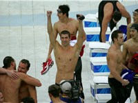 Michael Phelps celebrates with his team-mates after winning his 8th gold medal.