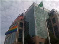 Flags raised in front of the Microsoft Sammamish Campus in Issaquah, Washington. The flag on the lef
