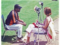 Miguel Tejada talks to reporter Kelli Johnson 2005.