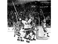 U.S. captain Mike Eruzione (left) celebrates with Bill Baker (center) moments after scoring the deci