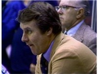 Coach Herb Brooks calms his players' nerves during the game.