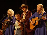 From left, Emmylou Harris, Neil Young and Pegi Young perform in Jonathan Demme's Neil Young: Heart o