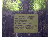 A sign in Bluefields in English (top), Spanish (middle) and Miskito (bottom).