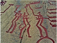 Supposed twin gods in battle-axe fight from the rock carvings in Tanumshede.(Red color was added rec