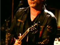 Bono playing guitar live during U2's 2001 Elevation Tour