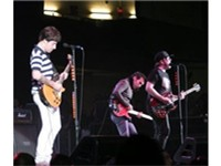 Fall Out Boy in concert. From left to right: Joe Trohman, Pete Wentz, Patrick Stump.