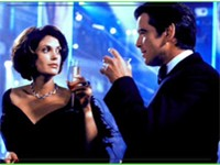 Brosnan (right) as James Bond in Tomorrow Never Dies.