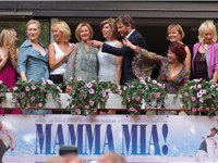 Brosnan (2nd from the left) with the cast of Mamma Mia! and ABBA (1st, 5th, and 6th from left and 2n