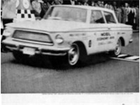 1962 American winning the Mobil Economy Run in an advertisement for Champion spark plugs.
