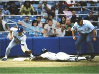 Henderson steals third base for the New York Yankees in 1988.