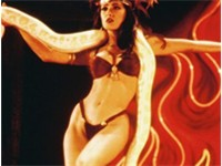 Bikini-clad Salma Hayek, as Santanico Pandemonium, performs an erotic dance with a snake in this pro