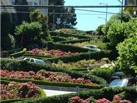 Cars negotiate Lombard Street to descend Russian Hill.