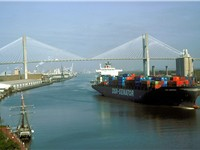 A container ship leaves the Port of Savannah after passing under the Talmadge Memorial Bridge and pr