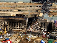 The Pentagon damaged by fire and partly collapsed.