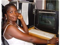 Isata Mahoi shown editing radio programmes in Talking Drum studio Freetown, she is also an actress i