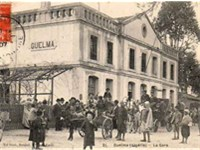 People gather in front of Guelma's train station (19th century postcard)