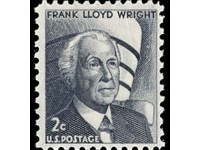 A 1966 U.S. postage stamp honoring Frank Lloyd Wright, with the Guggenheim visible in the background