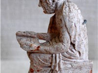 A marble relief of a poet, perhaps Sophocles.