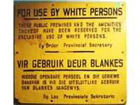 """For use by white persons""  -- sign from the apartheid era."
