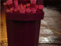 A bin overflowing with Starbucks cups