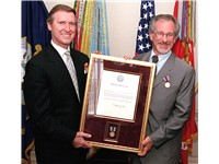 Spielberg with a public service award presented by United States Secretary of Defense William Cohen,