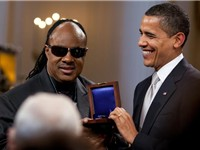 Wonder being presented the Gershwin Award for Lifetime Achievement by United States president Barack